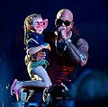 Recording artist Flo Rida holds 7-year-old Sophia Cervantes, daughter of U.S. Invictus team athlete Rafael Cervantes, during a live music performance for the closing ceremonies of the 2016 Invictus Games (26898329992) (cropped1).jpg