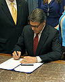 Rick Perry signs Chris Kyle Bill.jpg