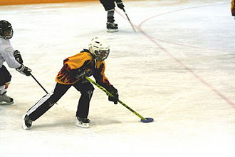 Ringette - A young girl playing Ringette