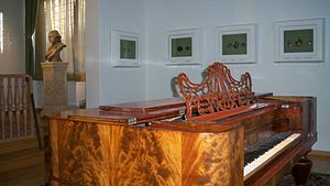 Peter Adolf Hall - Peter Adolf Hall's 18th century room. The piano represents a central part of the artistic Hall family life as one of the daughters was playing it, often together with her father on flute. Some of his miniature works are framed on the wall, Borås Art Museum