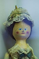 Rosy-cheeked antique doll (25419949394).jpg