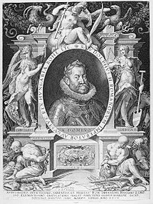 A round-faced bearded man wearing a crown of laurel