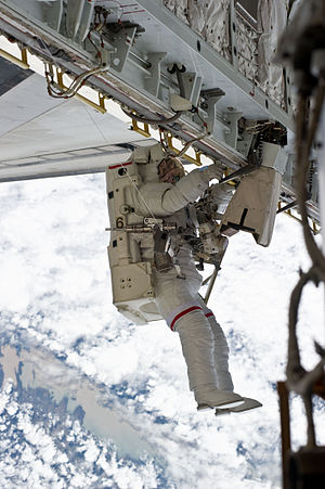 Simplified Aid For EVA Rescue - Astronaut Rick Mastracchio working with a SAFER system attached.