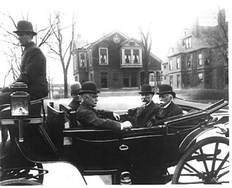 William S. Linton - William S. Linton (3rd from left) with dignitaries attend the construction site of Saginaw's City Auditorium on South Washington and Janes in 1908. From left to right: Unknown (driver), Edward Hartwick (editor), William S. Linton, Mayor William B. Baum, Wellington R. Burt (businessman).