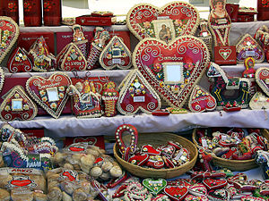 Gingerbread house - Decorated gingerbread hearts with mirrors, hussars, and market souvenirs in Croatia
