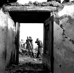 The North Saskatchewan Regiment - Personnel of the Saskatoon Light Infantry firing a 3-inch mortar, near Ortona, Italy, January 5, 1944