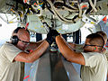 Senior Airman Daniel Babis, left, and Airman 1st Class Anthony Rodriguez attach an umbilical connector to a training AGM-86B conventional air-launched cruise missile during a B-52 Stratofortress load demonstrat 121017-F-FD161-932.jpg