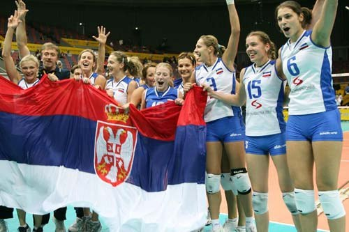 Serbian women's volleyball team cheering with flag, 2006