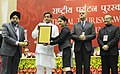 Shashi Tharoor presented the National Tourism Awards, at a function, in New Delhi on February 18, 2014. The Secretary, Ministry of Tourism, Shri Parvez Dewan is also seen.jpg