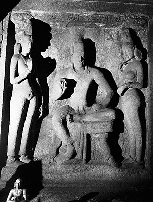 Simhavishnu - Simhavishnu with his queens: sculpture found in Adivaraha mandapam in Mahabalipuram. This is dated to the reign of his grandson, Narasimhavarman Mahamalla (630–668).