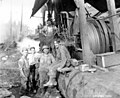Six men with donkey engine, Nehalem Timber & Logging Company, Scappoose, ca 1922 (KINSEY 2427).jpeg