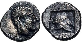 Scione - Coinage of Skione. Male head right, wearing tainia / Helmet right within incuse square. Circa 470-454 BC