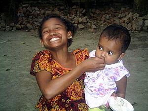Smiling From Heart: A child is Feeding (is a m...