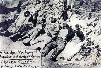 Greek genocide - Photo taken after the Smyrna fire. The text inside indicates that the photo had been taken by representatives of the Red Cross in Smyrna. Translation: Elderly and Children Were Not Spared