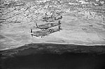 Spitfire LF Mk Vs of No. 244 Wing flying over the Tunisian coast after escorting light bombers on a sortie to Mareth, 23 March 1943. CNA821.jpg