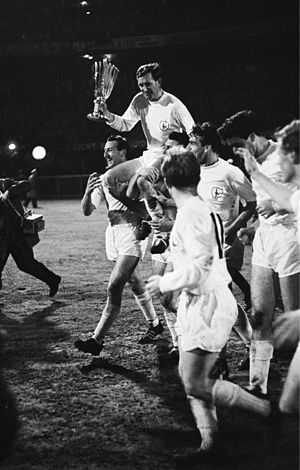 Danny Blanchflower - Blanchflower holding the UEFA Cup Winners' Cup trophy in 1963 after beating Atlético Madrid