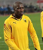 A young man wearing a yellow shirt