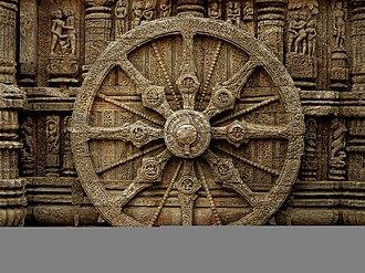 Konark Sun Temple - Stone Sun Dial, total of 24 in count representing the clock.
