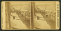 Street thronged with buggy and wagon traffic, by S. C. Reed.png