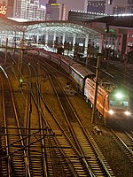 T164 leaves Shanghai Railway Station.jpg