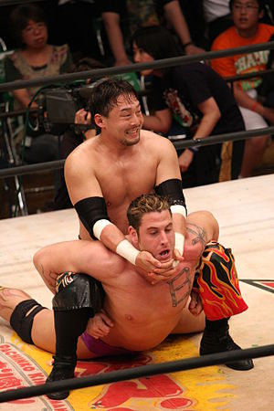 Professional wrestling holds - Yoshihiro Tajiri applying a camel clutch to Rene Bonaparte