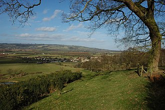 Teddington, Gloucestershire - View of Teddington and Bredon Hill beyond from the footpath from Oxenton where it emerges from the Belt (2008)