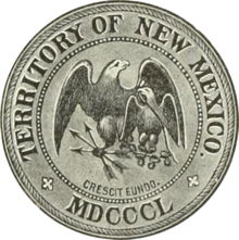 Greyscale drawing of a seal shows 'Territory of New Mexico', 'MDCCCL', and 'crescit eundo' in rings around the edge (separated by crosses patoncé); in the center an American heraldic eagle holding three arrows protects a smaller Mexican heraldic eagle holding a snake and sitting on a nopal.