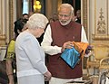 The Prime Minister, Shri Narendra Modi presents gifts to Her Majesty Queen Elizabeth II, of the United Kingdom, in London on November 13, 2015 (1).jpg
