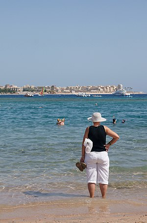 Tourist standing on the beach of Makadi Bay, E...