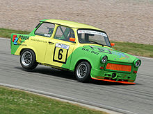 Green-and-yellow Trabant on a track