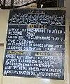 TrilingualSignElevator SlavosBuildingKhartoum RomanDeckert022015cropped.jpg