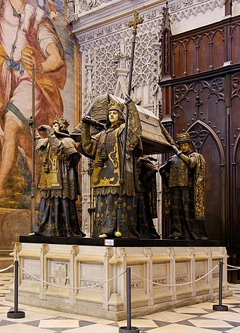 Tomb in Seville Cathedral. The remains are borne by kings of Castile, Leon, Aragon, and Navarre. Tumba de Colon-Sevilla.jpg