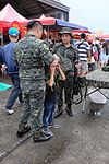 Two ROCMC Soldiers Helping Boy Experience Equipment in 2016 Hualien AFB Open Day 20160813.jpg