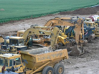 Heavy equipment - Heavy equipment vehicles of various types parking near a highway construction site