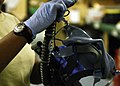 U.S. Air Force Senior Airman Charlene Grant, an aircrew flight equipment technician assigned to the 445th Expeditionary Operation Support Squadron, inspects an oxygen mask while wearing gloves at Bagram 091102-F-TG495-518.jpg