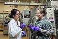 U.S. Army 2nd Lt. Nicole Boda, right, a maintenance officer for the 863rd Engineer Battalion, interacts with Kristine Tanabe, a postdoctoral catalyst development specialist, at the Argonne National Laboratory 140826-A-TI382-410.jpg