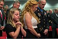 U.S. Army Staff Sgt. Ty Carter, right, and his family bow their heads during a Hall of Heroes induction ceremony Aug. 27, 2013, at the Pentagon in Arlington, Va 130827-D-KC128-052.jpg