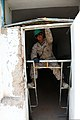 U.S. Marine Corps Pfc. Ismael Moctezunadelalanza, a bulk fuel specialist with the 9th Engineer Support Battalion, 3rd Marine Logistics Group, tears down an old window frame while working on a renovation project 130726-M-MG222-003.jpg