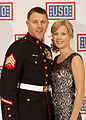U.S. Marine Corps Sgt. Andrew C. Seif, left, poses for a photo with his wife during the reception before the 2013 USO Gala in Washington, D.C. on Oct. 25, 2013 131025-M-KS211-002.jpg
