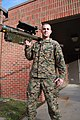 U.S. Marine Corps Sgt. Clifford F. Morley, improved movement target simulator non-commissioned officer with 2nd Low Altitude Air Defense Battalion, holds a Stinger missile at the battalions simulator 121227-M-EG384-006.jpg