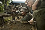 U.S. Marine shows a Philippine Marine how to use an M110 semi-automatic sniper system.jpg