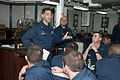 U.S. Navy Capt. Brad Cooper, left, the commanding officer of the guided missile cruiser USS Gettysburg (CG 64), speaks with the crew during an all-hands call in the Gulf of Oman Dec. 13, 2013 131213-N-PL185-040.jpg