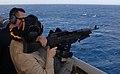 U.S. Navy Capt. Cindy Thebaud, the commander of Africa Partnership Station 2009, fires an M240 machine gun aboard amphibious transport dock ship USS Nashville (LPD 13) 090119-N-AC223-341.jpg
