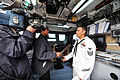 U.S. Navy Electronic's Technician 1st Class Luis Carrasco, right, answers questions from media aboard the patrol coastal ship USS Hurricane (PC 3) as part of Milwaukee Navy Week in Milwaukee, Wis., Aug. 9, 2012 120809-N-YZ751-051.jpg