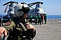 U.S. Navy Naval Air Crewman 2nd Class Jon Olson, assigned to Helicopter Sea Combat Squadron (HSC) 23, communicates with the pilot of an MH-60 Seahawk helicopter during preflight checks on the flight deck of 110417-N-ZS026-030.jpg