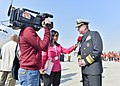 U.S. Navy Vice Adm. John W. Miller, right, the commander of U.S. Naval Forces Central Command, U.S. 5th Fleet and Combined Maritime Forces, speaks to a reporter during the Bahrain International Air Show 140116-N-VY489-453.jpg