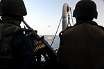 U.S. Sailors man an M2 .50 caliber machine gun aboard the guided missile destroyer USS Halsey (DDG 97) during the boarding of two Yemeni dhows in the Gulf of Aden Feb. 5, 2012 120205-N-RP435-417.jpg