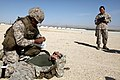 U. S. Marine Cpl. Ruelito Cabral with Headquarters and Service Company, Combat Logistics Regiment 2, 2nd Marine Logistics Group, practices lifesaving skills on a simulated casualty as he undergo combat lifesaver 120905-M-KS710-016.jpg