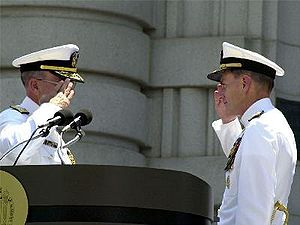 Military courtesy - Admiral Jay L. Johnson and Admiral Vern Clark of the United States Navy salute each other during a change-of-command ceremony. Clark is relieving Johnson as Chief of Naval Operations.