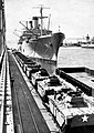 USS General W.A. Mann (T-AP-112) loading LVTs at NSC Oakland in 1950.jpg